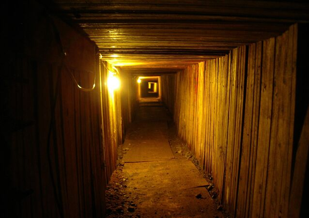 In this file photo provided on July 21, 2005 by British Columbia's Combined Forces Special Enforcement Unit, the interior of an elaborate, 350-foot drug-smuggling tunnel dug underneath the U.S.-Canadian border near Lynden, Wash. is shown