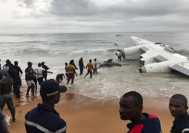 People pull the wreckage of a propeller-engine cargo plane after it crashed in the sea near the international airport in Ivory Coast's main city, Abidjan, October 14, 2017