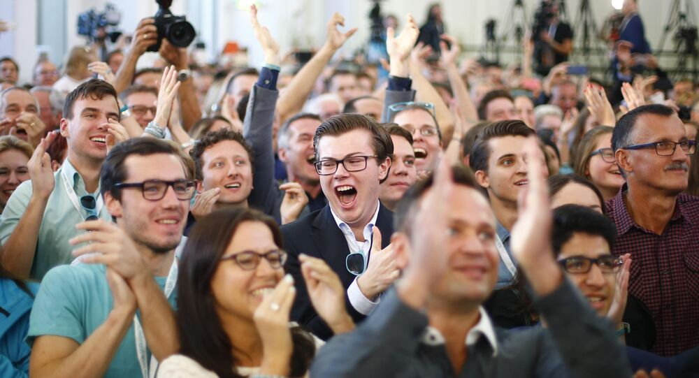 Supporters of the Peoples Party (OeVP) react after first exit polls, during the party meeting in Vienna, Austria October 15, 2017