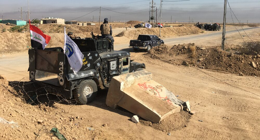 Members of Iraqi federal forces are seen near the oil fields in Kirkuk, Iraq October 16, 2017