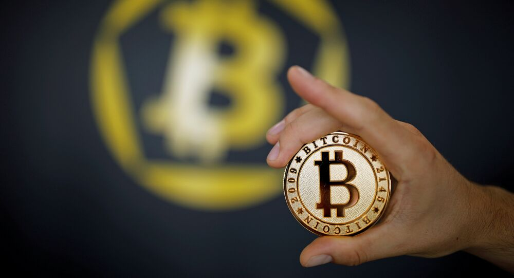 A Bitcoin (virtual currency) coin is seen in an illustration picture taken at La Maison du Bitcoin in Paris, France, June 23, 2017