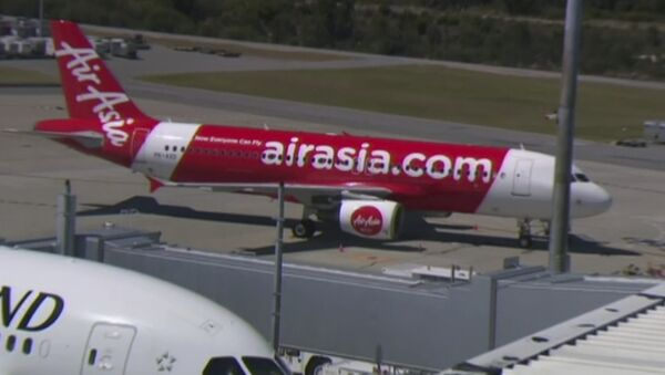 This Sunday, Oct. 15, 2017 image made from video shows an AirAsia plane at an airport in Perth, Australia. - Sputnik International
