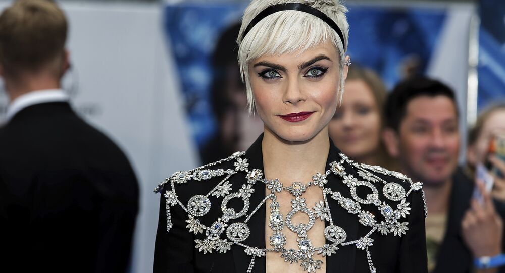 Actress Cara Delevingne poses for photographers on arrival at the premiere of the film 'Valerian', in London, Monday, July 24, 2016.