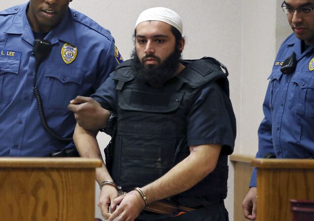 Ahmad Khan Rahimi, the man accused of setting off bombs in New Jersey and New York in September is led into court in Elizabeth, N.J
