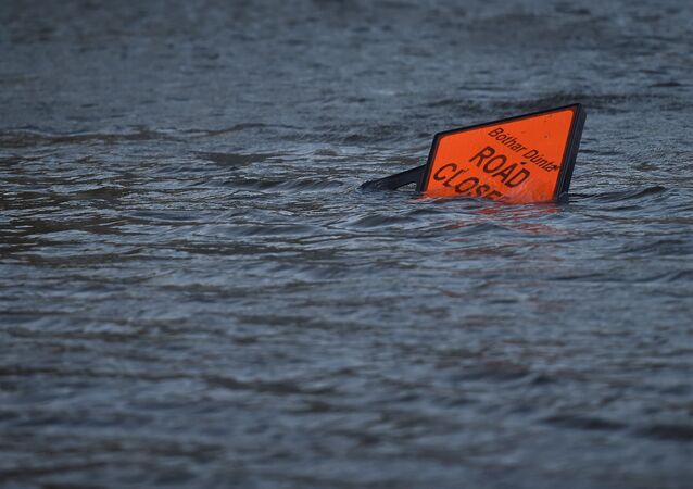 A 'road closed' sign is seen submerged in floodwater during Storm Ophelia in Galway, Ireland October 16, 2017.