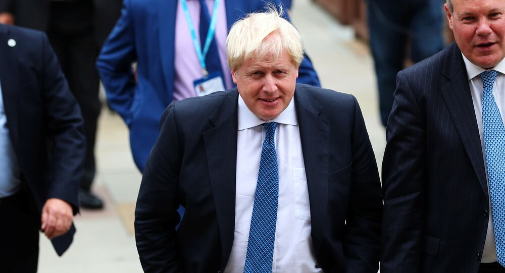 Britain's Foreign Secretary Boris Johnson arrives at the Conservative Party conference in Manchester, Britain October 3, 2017