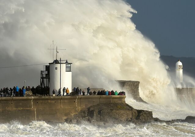 Waves crash over the lighthouse as storm Ophelia passes Porthcawl, Wales, Britain, October 16, 2017.