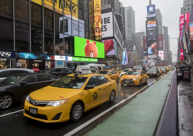 In this Thursday, May 25, 2017, file photo, traffic makes its way down Seventh Avenue in New York's Times Square