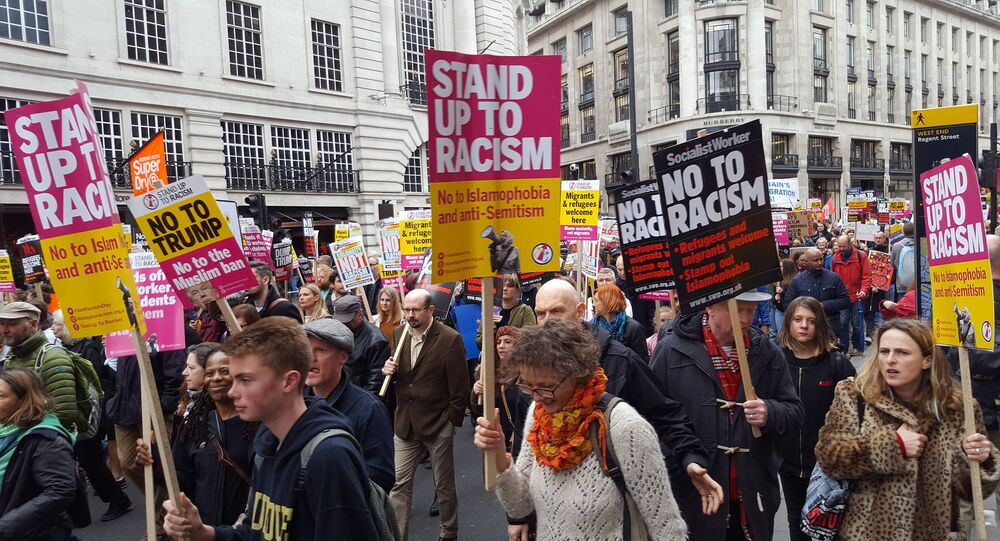 People demonstrate through the streets of central London to protest against racism amid debates about the place of migrants in Britain after the anticipated exit from the European Union (Brexit), Saturday March 18, 2017