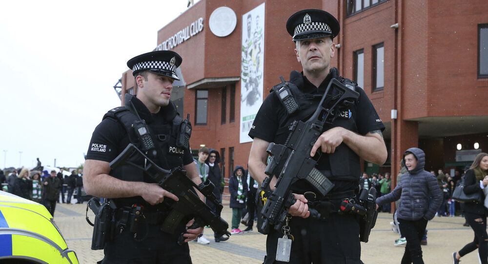 Armed police outside Celtic Park before the Scottish Premiership soccer match at Celtic Park in Glasgow, Scotland, Saturday 16 September 2017.