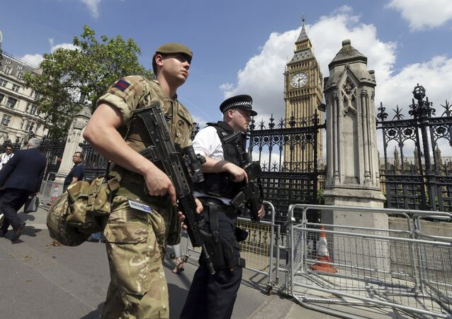 A member of the army joins police officers in Westminster, London, Wednesday, May 24, 2017.