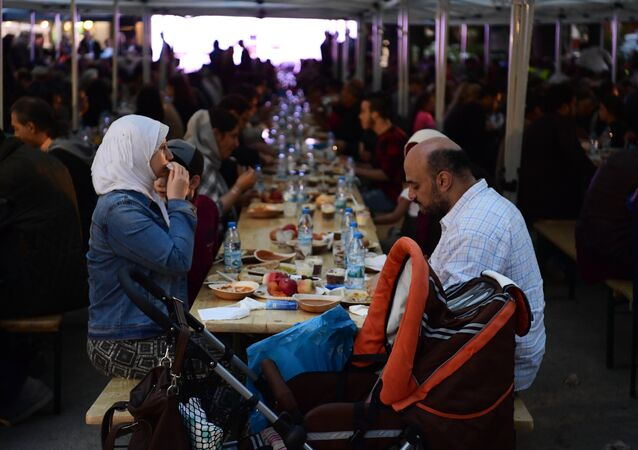 Members of the Muslim community eat at a Ramadan fasten break in Berlin. (File)