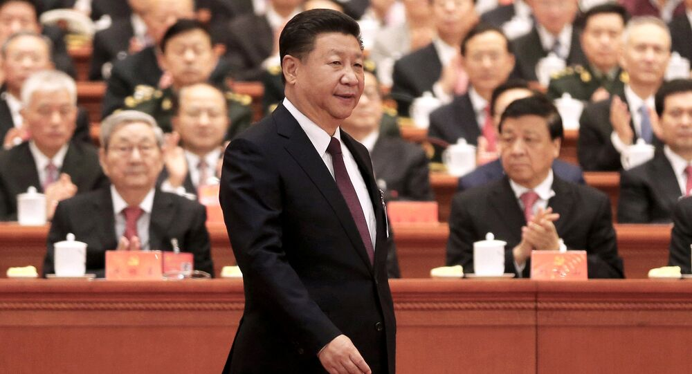 Chinese President Xi Jinping walks to the lectern to deliver his speech during the opening session of the 19th National Congress of the Communist Party of China at the Great Hall of the People in Beijing, China October 18, 2017.