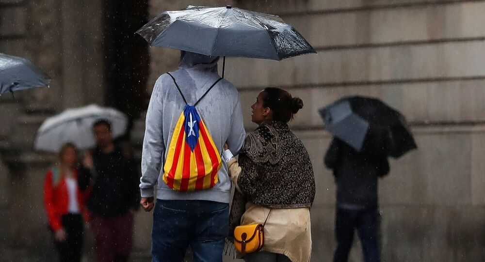 A man with a backpack in the colors of a Catalan separatist flag passes near the regional government headquarters the Generalitat, after the final ten o'clock deadline set by Spain's government for Catalan President Carles Puigdemont to retract an ambiguous declaration of independence, in Barcelona, Spain, October 19, 2017