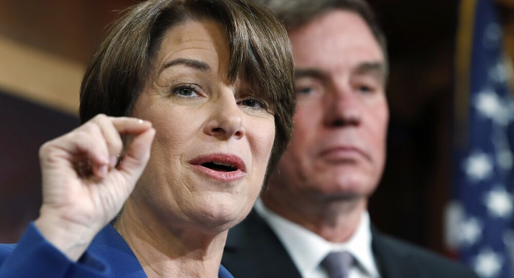 Sen. Amy Klobuchar, D-Minn., left, and Sen. Mark Warner, D-Va., speak about online political ads and preventing foreign interference in U.S. elections, during a news conference on Capitol Hill in Washington