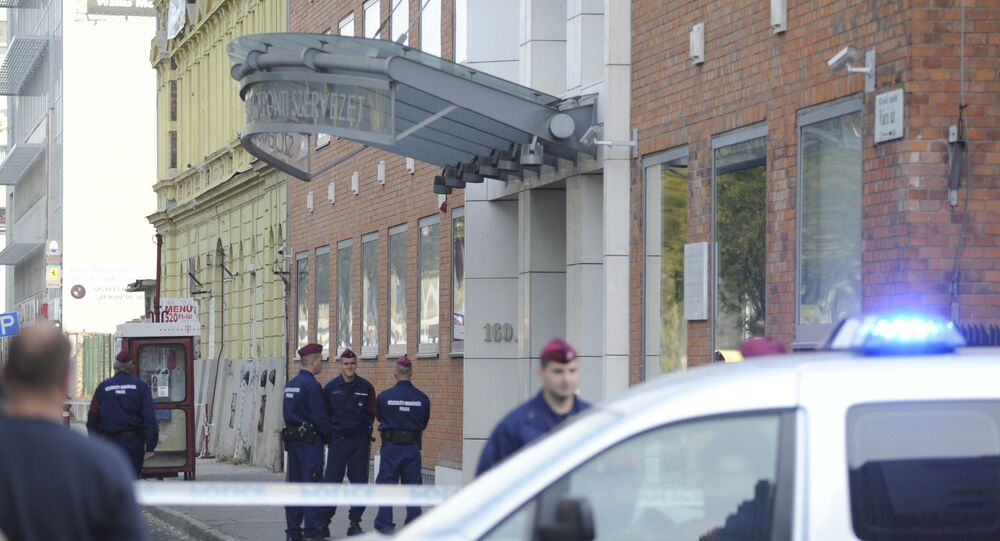Police officers stand in front of the entrance of the Church of Scientology of Budapest headquarters in Vaci Road in Budapest, Hungary, Wednesday, Oct. 18, 2017.