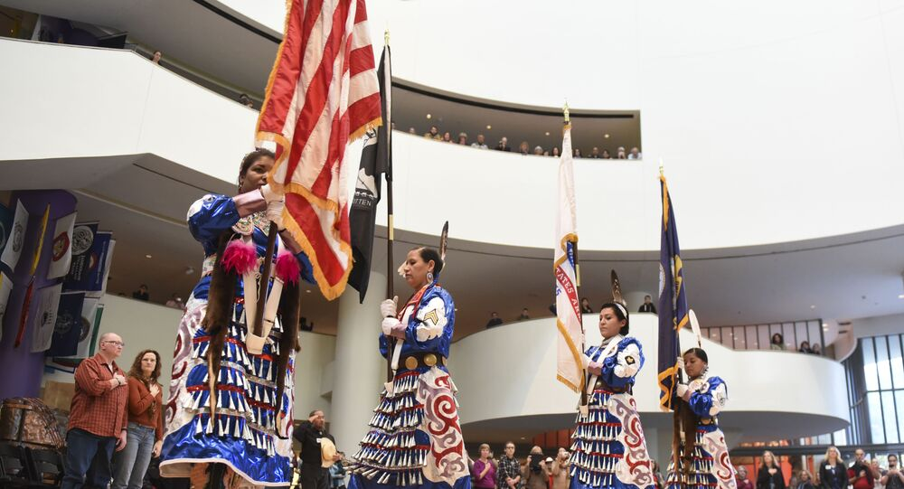 Native American Women Warriors, from left, Takara Matthews (Sokoki Abenaki/Lumbee) Jamie Awonohopay (Menominee), Elizabeth Haas (Northern Arapaho Tribe), Antonia Thomas (Navajo), all veterans of the U.S. Armed Forces, take part in the Presentation of the Colors during a Veterans Day celebration at Smithsonian's National Museum of the American Indian on Friday, Nov. 11, 2016 in Washington