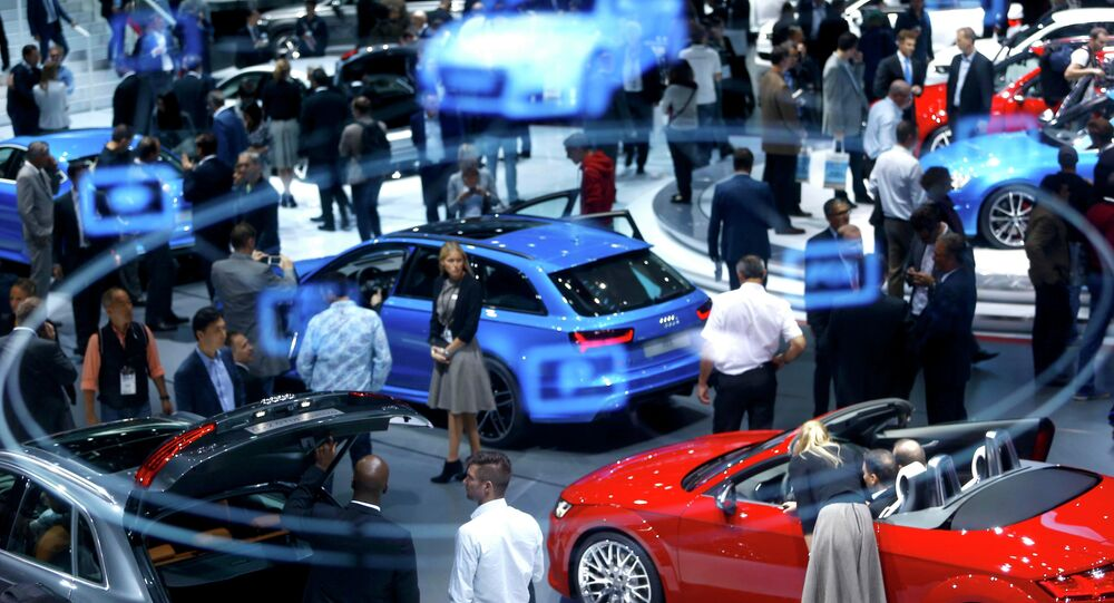 A projection of the Virtual Cockpit is seen as visitors inspect cars presented at the Audi stall during the media day at the Frankfurt Motor Show (IAA) in Frankfurt, Germany September 16, 2015