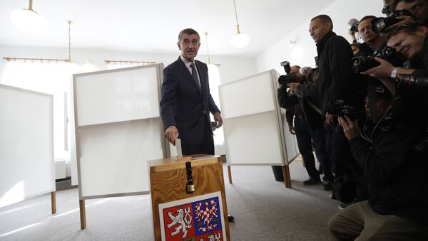 Czech billionaire and leader of the ANO 2011 political movement Andrej Babis casts his vote during the parliamentary elections in Pruhonice, Czech Republic, Friday, Oct. 20, 2017 - Sputnik International