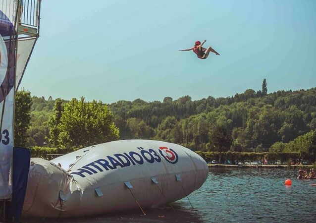 Jumping into Berlin's Ploetzensee Lake