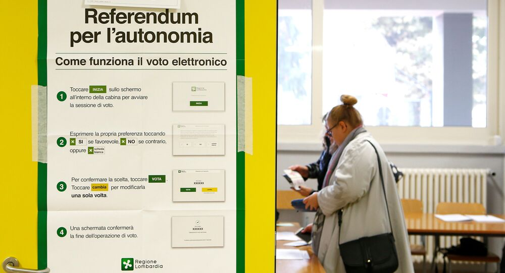 A poster with instructions about Lombardy's autonomy referendum is seen at a polling station in Lozza near Varese, northern Italy, October 22, 2017