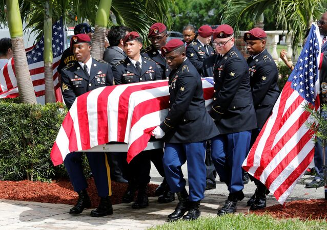 An honor guard carries the coffin of US Army Sergeant La David Johnson, who was among four special forces soldiers killed in Niger, at a graveside service in Hollywood, Florida, October 21, 2017.