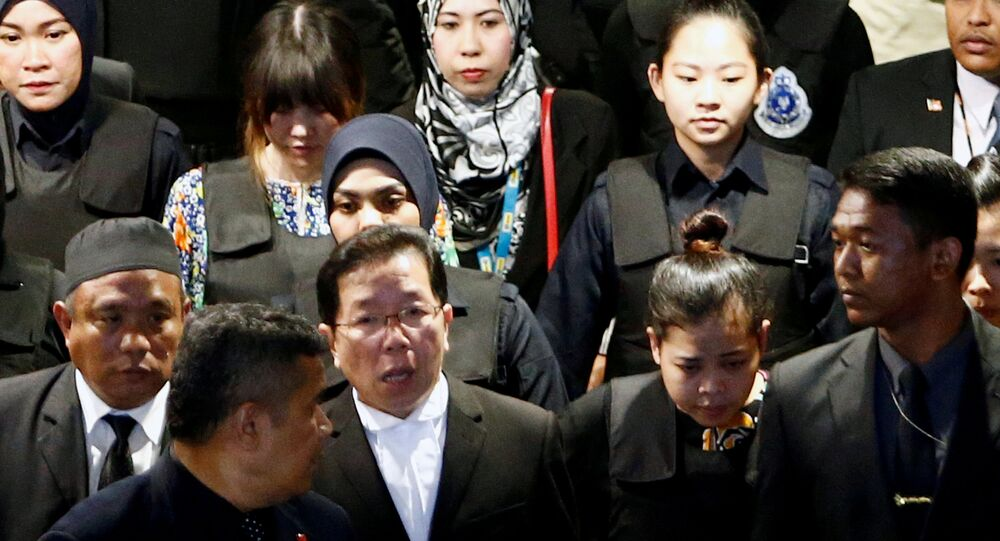 Indonesian Siti Aisyah and Vietnamese Doan Thi Huong, who are on trial for the killing of Kim Jong Nam, the estranged half-brother of North Korea's leader, are escorted as they revisit the Kuala Lumpur International Airport 2 in Sepang, Malaysia October 24, 2017.