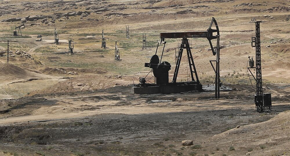 This July 30, 2017 photo, shows an oil field controlled by the Kurdish-led Syrian Democratic Forces (SDF), in Rmeilan, Hassakeh province, northeast Syria.