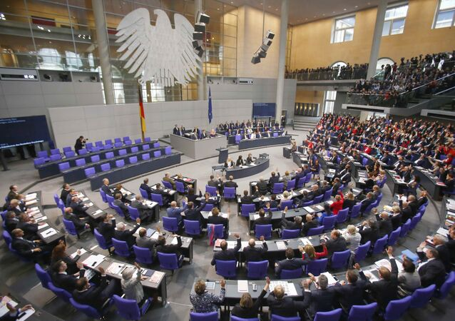 Delegates vote during the first plenary session at the German lower house of Parliament, Bundestag, after a general election in Berlin, Germany, October 24, 2017.