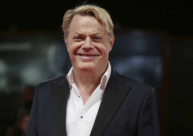 Actor Eddie Izzard poses for photographers at the premiere of the film 'Victoria and Abdul' during the 74th edition of the Venice Film Festival in Venice, Italy, Sunday, Sept. 3, 2017.