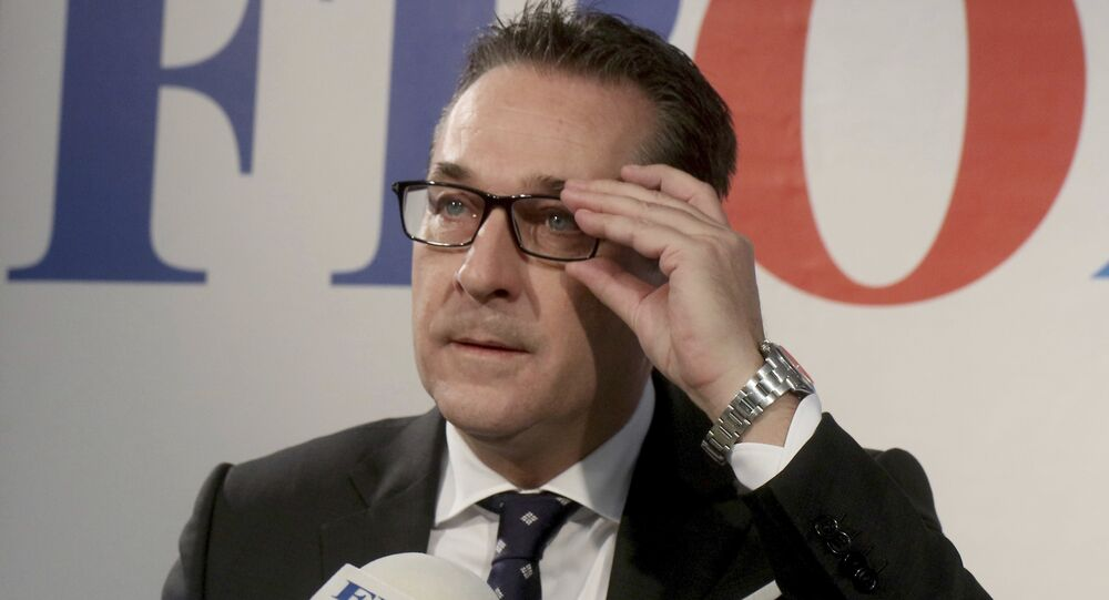 Heinz-Christian Strache, chairman of the right-wing Freedom Party, FPOE, adjusts his glasses during a news conference in Vienna, Austria, Tuesday, Oct. 24, 2017