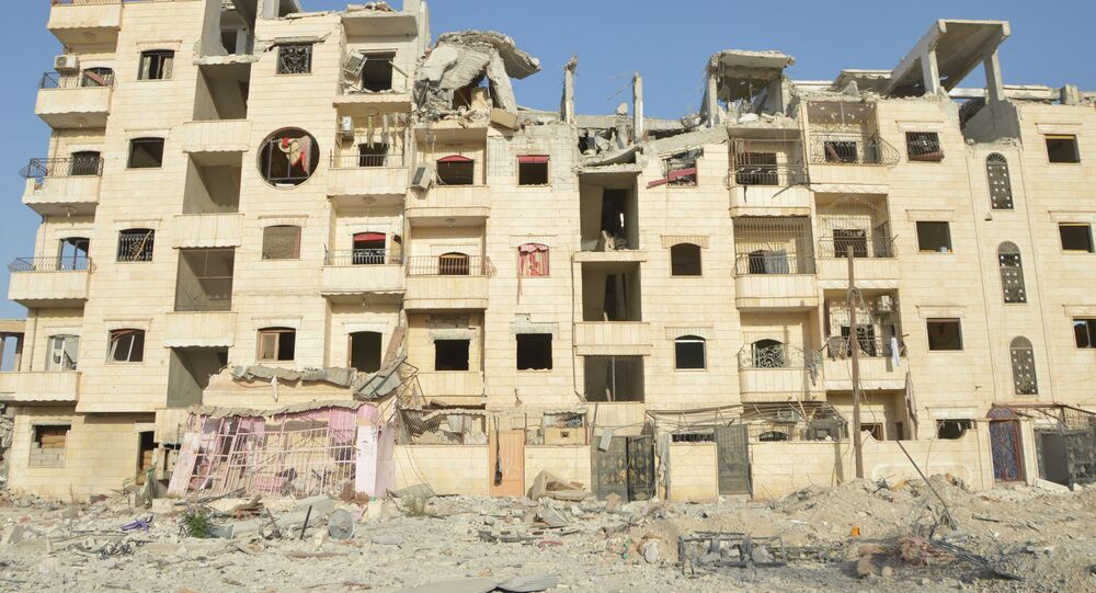 Damaged building of the liberated Al-Raqqah Province