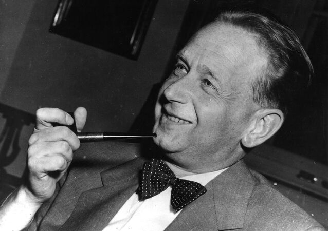 In this May 19, 1953 file photo, Dag Hammarskjold, recently appointed secretary general of the United Nations who is on a visit to Sweden, smokes his pipe at a press conference held at the Foreign Office in Stockholm.