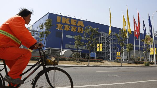 A public worker rides a bicycle in front of an Ikea shop Wednesday March 6, 2013 in Shanghai, China. Chinese authorities say they have destroyed nearly two tons of chocolate cake imported by Sweden's Ikea for violating food quality standards. - Sputnik International