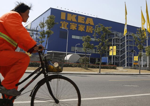 A public worker rides a bicycle in front of an Ikea shop Wednesday March 6, 2013 in Shanghai, China. Chinese authorities say they have destroyed nearly two tons of chocolate cake imported by Sweden's Ikea for violating food quality standards.