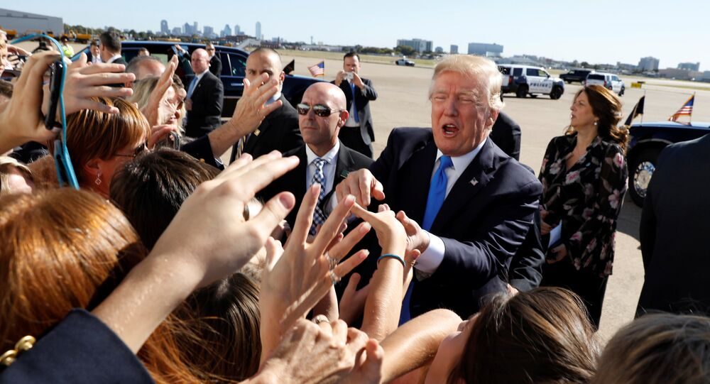 U.S. President Donald Trump greets well wishers upon his arrival at Dallas Love Field in Dallas, Texas, U.S, October 25, 2017