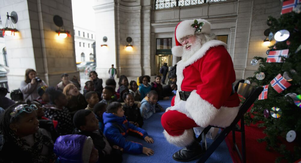 Santa Claus entertains children at the foot of the Norwegian Christmas tree at Union Station in Washington, Tuesday, Dec. 1, 2015