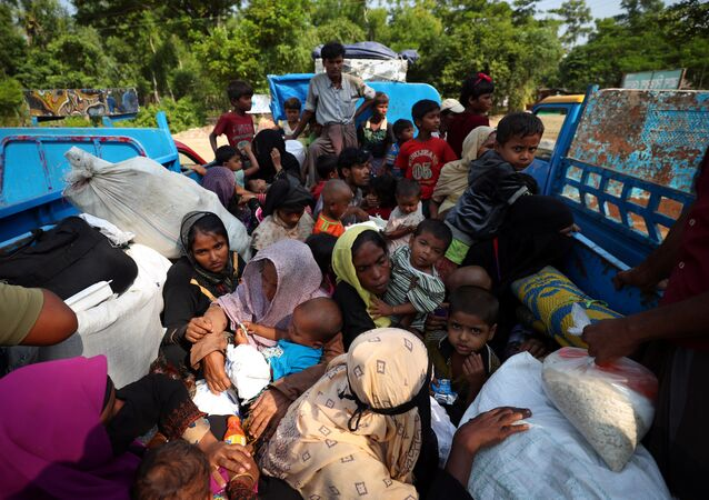 Rohingya refugees who arrived from Myanmar wait on a truck that will take them to a refugee camp from a relief centre in Teknaf, Bangladesh, October 25, 2017
