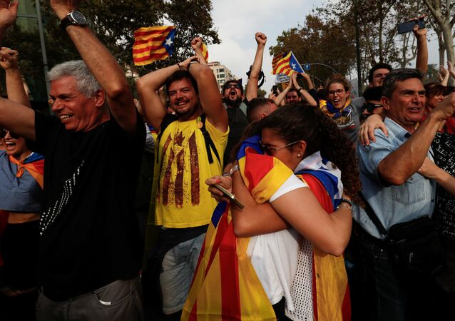 People celebrate after the Catalan regional parliament declares the independence from Spain in Barcelona, Spain, October 27, 2017