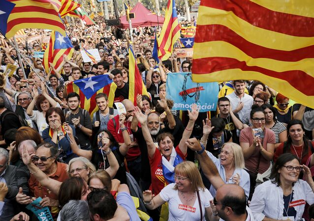 People celebrate after Catalonia's parliament voted to declare independence from Spain on October 27, 2017 in Barcelona
