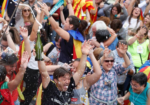 People celebrate after the Catalan regional parliament passes the vote of independence from Spain in Barcelona, Spain