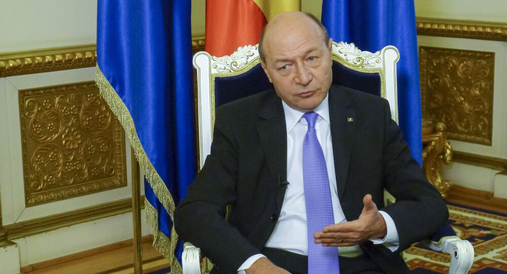 President Traian Basescu speaks during interview with The Associated Press on Monday, March 17, 2014 at the Cotroceni Palace which houses the president's offices.
