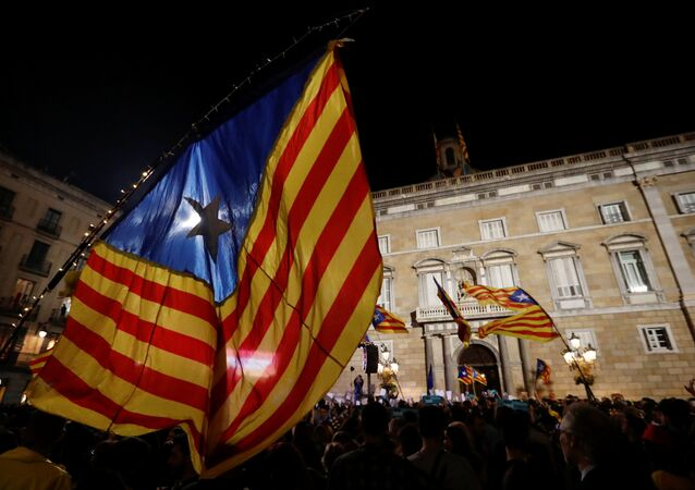 People celebrate and wave Catalan separatist flags in Sant Jaume square after the Catalan regional parliament declared independence from Spain in Barcelona, Spain, October 27, 2017