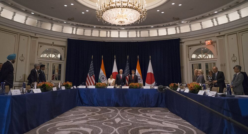 U.S. Secretary of State Rex Tillerson, center at center table, stands with Indian External Affairs Minister Sushma Swaraj, left, and Japanese Foreign Minister Taro Kono, at the Palace Hotel during a meeting in New York, Monday, Sept. 18, 2017
