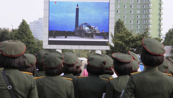 People fill the square of the main railway station to watch a televised news broadcast of the test-fire of an inter-continental ballistic rocket Hwasong-12, Wednesday, August 30, 2017, in Pyongyang, North Korea - Sputnik International
