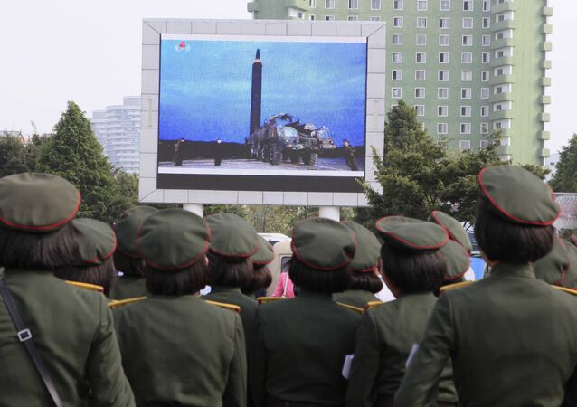 People fill the square of the main railway station to watch a televised news broadcast of the test-fire of an inter-continental ballistic rocket Hwasong-12, August 30, 2017, in Pyongyang, North Korea