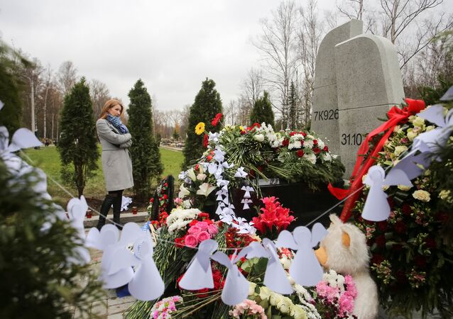 A woman attends an opening ceremony of a monument commemorating victims of the crash of Metrojet Airbus A321 in Egypt's Sinai peninsula in 2015, in St. Petersburg, Russia October 28, 2017
