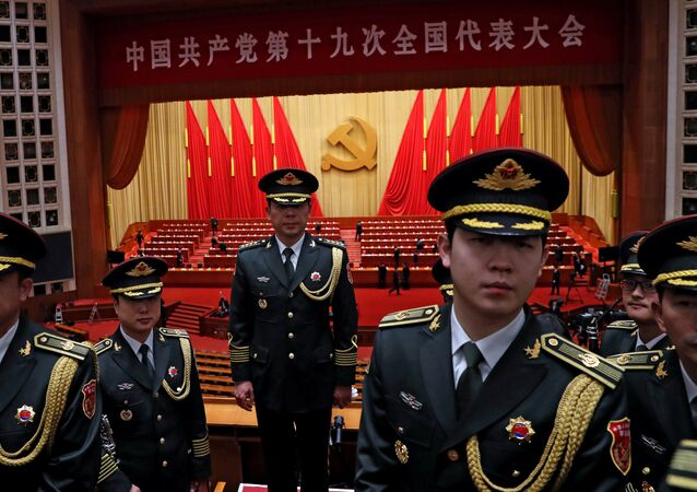 Military band members react after the closing session of the 19th National Congress of the Communist Party of China at the Great Hall of the People, in Beijing, China October 24, 2017