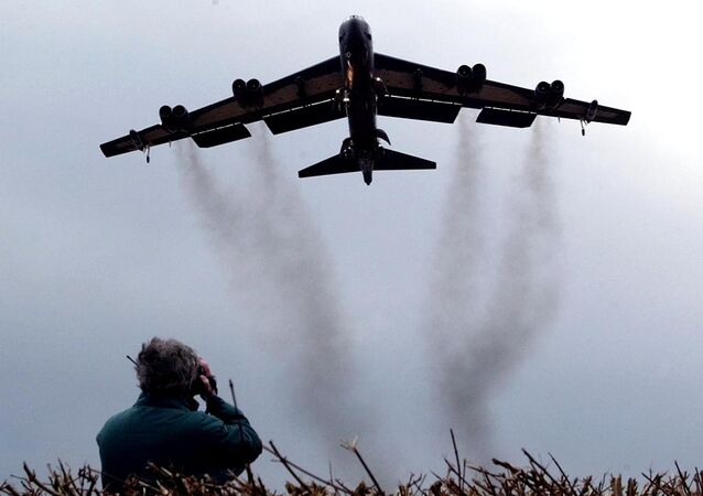 March 3, 2002 file photo shows a member of the public watching a US Air Force B 52 bomber arriving at RAF Fairford in western England.