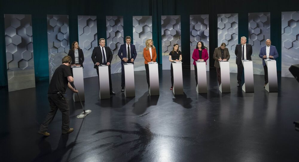 A worker cleans a floor as Iceland's political parties politicians attend a television debate in Reykjavik, Iceland October 27, 2017